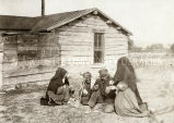 Sisters nursing Lakota couple, n.d.