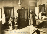 Brother Theordor Sturm, S.J., and Lakota boys in kitchen, n.d.