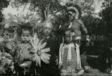 Father Jones, S.J., with children dressed to dance, n.d.