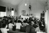 Youth praying at mass, n.d.