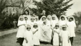 Father Sialm, S.J., and girls dressed for first communion, n.d.