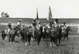 Mounted color guard at rodeo, n.d.