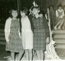Laughing students by corn stalk display, n.d.
