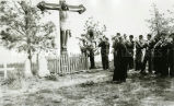 Marching band playing in cemetery, 1937