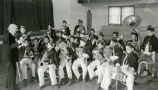 Marching band playing in auditorium, n.d.