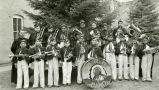 Father Adams, S.J., and Marching band, n.d.