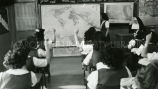 Student pointing to map, 1949
