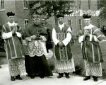 Bishop McCarty, C.Ss.R., with Jesuits vested for mass, n.d.