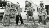 Oglala boys performing in chiefs' costumes, 1940