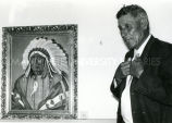 Chief Edgar Red Cloud viewing painting depicting Chief Red Cloud, undated