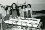Students with freshly baked and sliced bread, n.d.