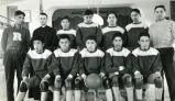 Coach Clifford, Father Adams, S.J., and boys' basketball team, n.d.