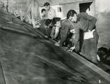 Students shingling a roof, n.d.
