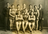 Coach Clifford and unidentified man with boys' basketball team, n.d.