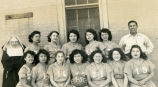 Girls' basketball team and Coach Emil Red Fish, 1950