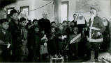 Santa Claus distributing Christmas presents, n.d.