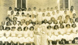 Bishop McCarty, C.Ss.R., and confirmation class, n.d.