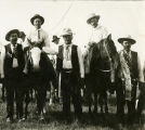 Cowboys standing and on horseback, n.d.