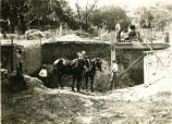 Workers constructing a dam on White Clay Creek, 1 of 2, 1938