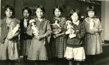 Students with dolls, n.d.