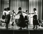 Student actors dancing in circle, n.d.