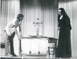 Student actor and actress acting on stage, n.d.