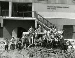 Faculty in front of Red Cloud High School, n.d.