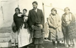 "Parents and five children in ""Sunday best"" clothes, n.d."