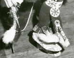 Close-up of dancing feet with bells, moccasins, and knee drops, n.d.