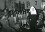 Student glee club and Franciscan sister, n.d.