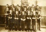 Boys with missals dressed in church for first communion, n.d.