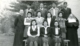 High school graduates with Father Adams, S.J., and Sister Adelaide, O.S.F., 1942
