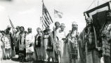 Women with flags honoring war veterans, n.d.
