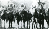 Five mounted equestrians dressed for parade, n.d.