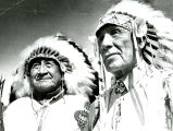 James Iron Cloud and Edgar Red Cloud in war bonnets, n.d.