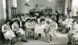 Students decorating linens with embroidery, 2 of 2, 1945