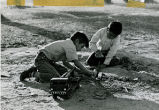 Boys on ground playing excavation work, 1966
