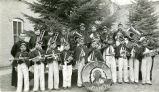 Elementary school band with Father Adams, S.J., and German bandmaster, n.d.