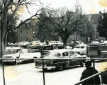 Vehicles parked at anniversary celebration, 1963