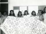 Students displaying quilt, n.d.