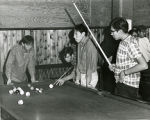 Student Mike Williams shooting pool, n.d.