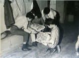 Boys reading cartoons, n.d.