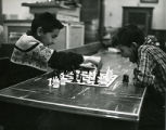 Boys playing chess, n.d.
