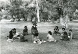 Girls gathered in circle, n.d.