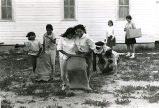 Children in three legged sack race, n.d.