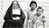 Franciscan sister and two girls, n.d.