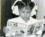 Kindergarten girl with head phones, n.d.