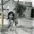 Girl on swing, n.d.