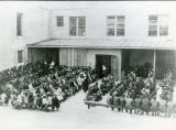Students and relgious sisters assembled outdoors, n.d.
