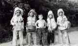 Boys in regalia with visiting boy, n.d.